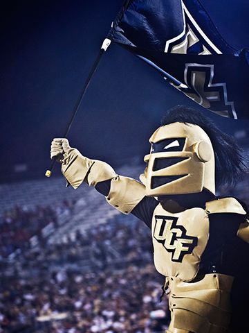 Knightro waving the UCF flag at the stadium