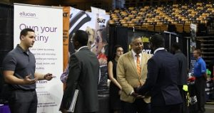 career fair with multiple job seekers and recruiters interacting
